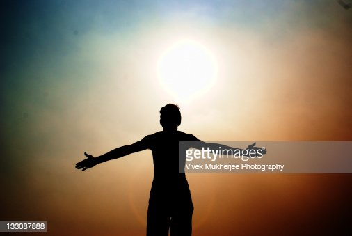 Silhouette of man standing front of sun  Stock Photo