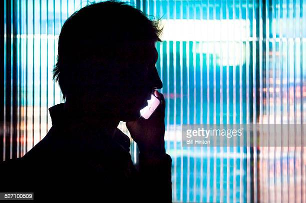 Silhouette of man talking on mobile phone Seattle office building