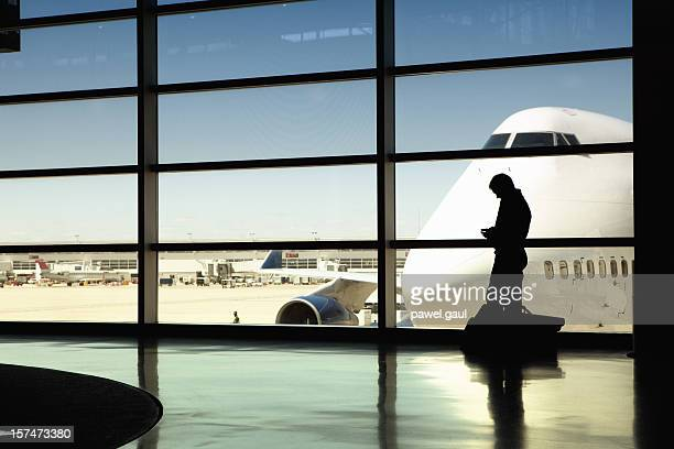 Silhouette of Man talking on phone at airport