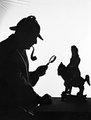 Silhouette of man wearing deerstalker, dressed as Sherlock Holmes. (Photo by H. Armstrong Roberts/Retrofile/Getty Images)