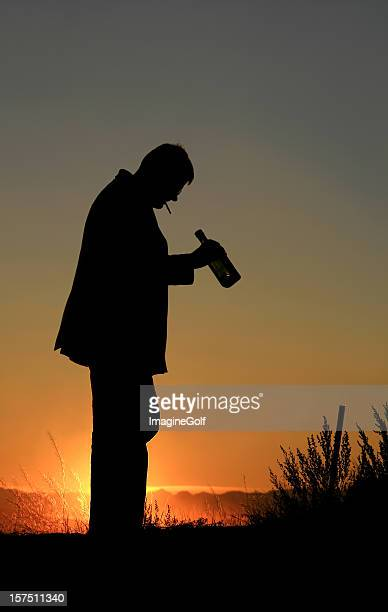 Silhouette of Man With Alcoholism and Addiction