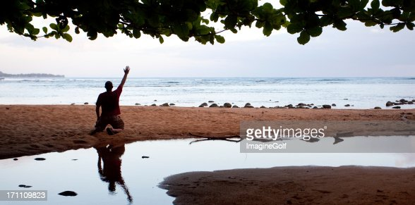 Man Praying On His Knees Stock Photos And Pictures Getty Images