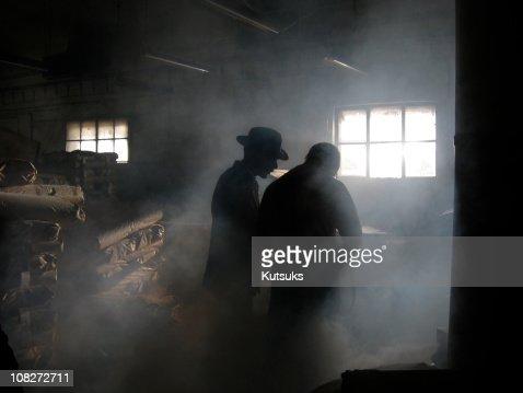 Silhouette of Men in Smoke