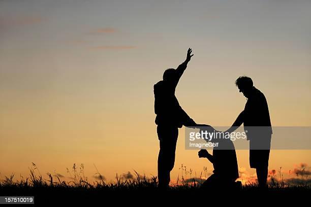 Silhouette of Men Praying