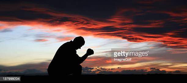Silhouette of Middle-Aged Man Praying