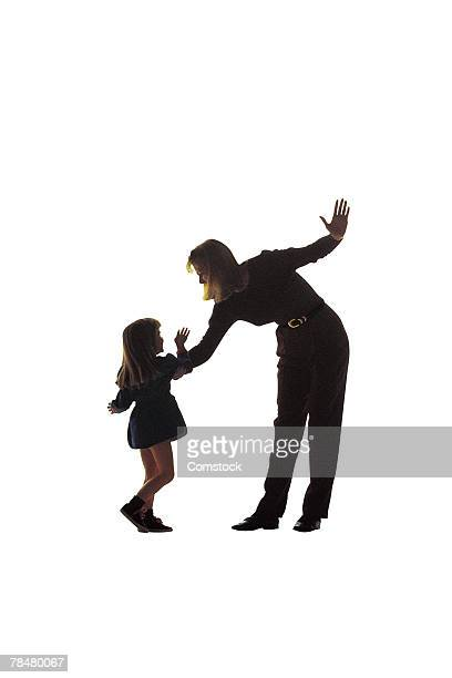 Silhouette of mother about to strike daughter