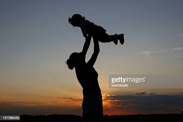 Silhouette of mother with baby girl