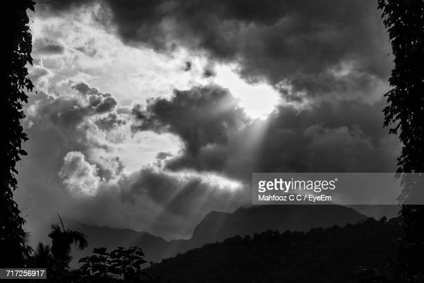 Silhouette Of Mountain Against Cloudy Sky
