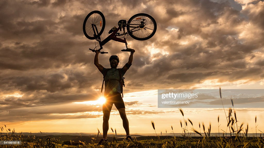 Silhouette of mountainbiker at the top