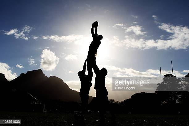 A silhouette of Nathan Sharpe catching the ball during an Australian Wallabies training session Bishops High School on August 23 2010 in Cape Town...