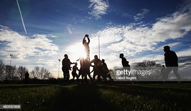 A silhouette of Northampton Saints practicing their lineouts during the Northampton Saints training session held at Franklin's Gardens on December 17...