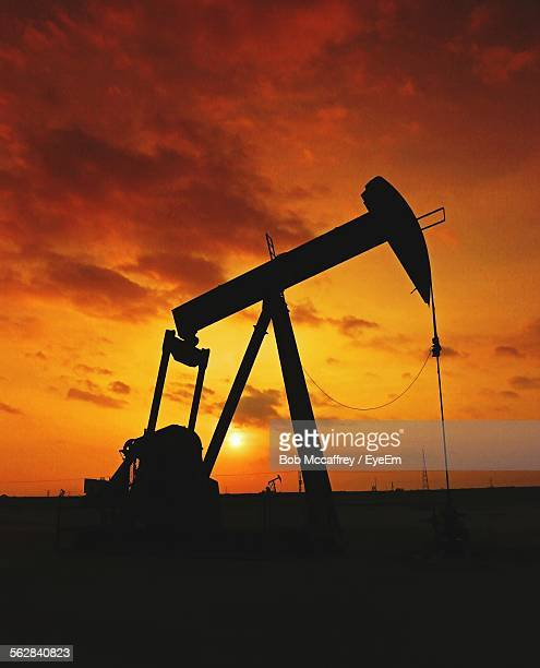 Silhouette Of Oil Well Pump At Sunset