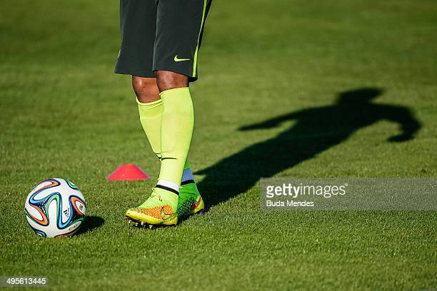 Silhouette of Paulinho in action during a training session of the Brazilian national football team at the squad's Granja Comary training complex in...