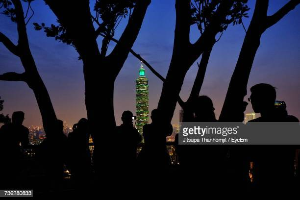 Silhouette Of People Against Taipei Cityscape