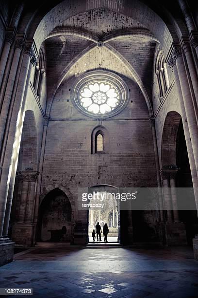 Silhouette of People Entering La Seu Vella Cathedral