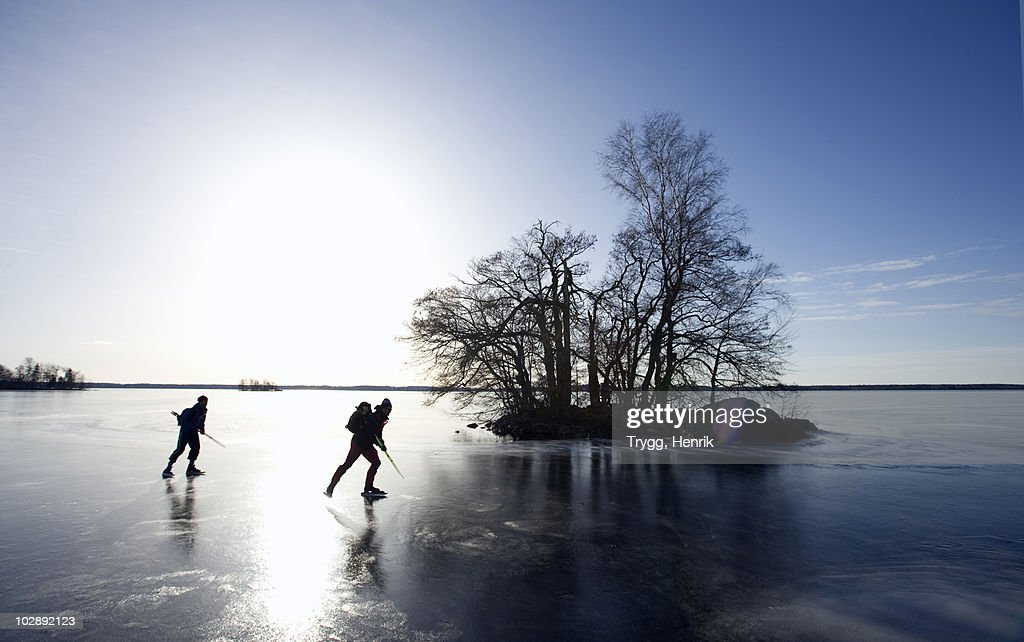 Silhouette of people ice skating : Stock Photo