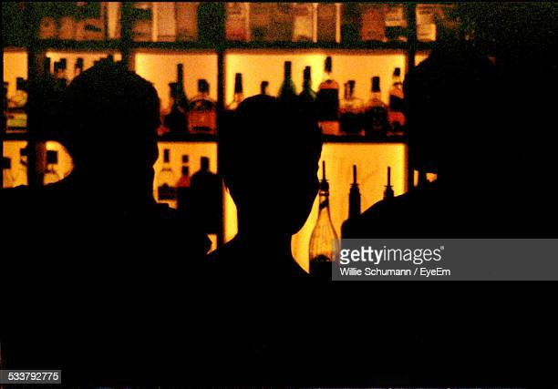 Silhouette Of People In Bar