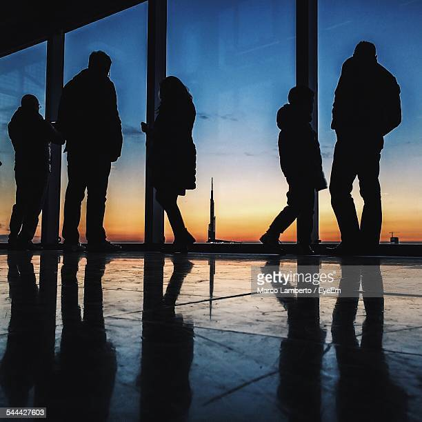 Silhouette Of People Looking At City