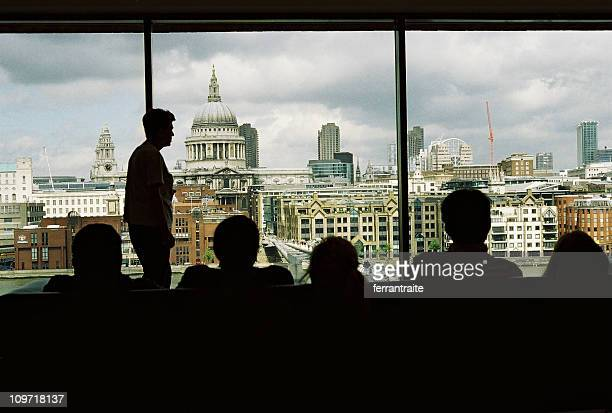 Silhouette of People Looking Out Window at London