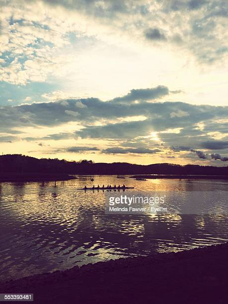 Silhouette Of People On Dragon Boat