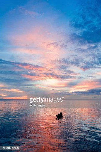 Silhouette of People Rowing Boat : Bildbanksbilder