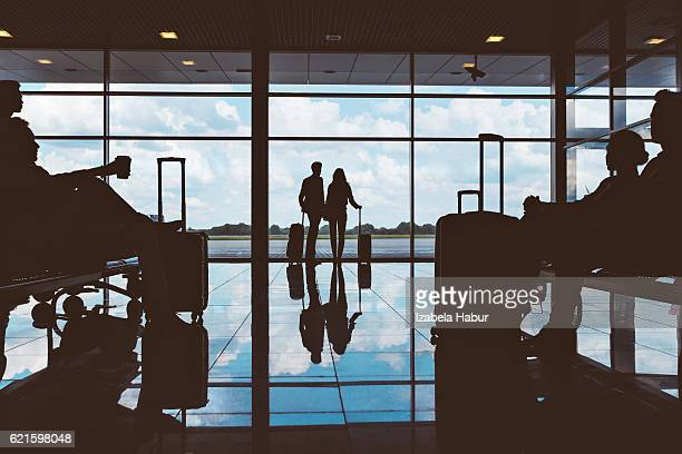 Silhouette of people waiting at airport lounge