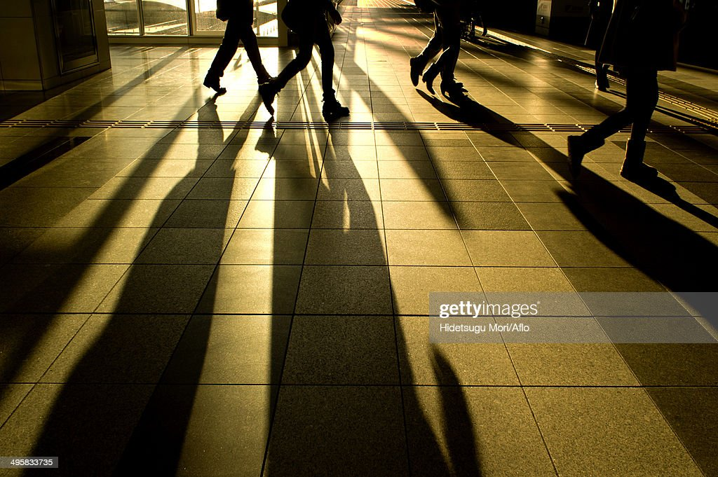Silhouette of people walking, Japan