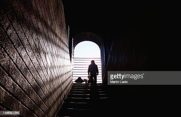 Silhouette of person climbing Giralda stairs.