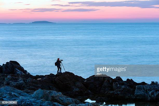 Silhouette of Photographer With Camera and Tripod