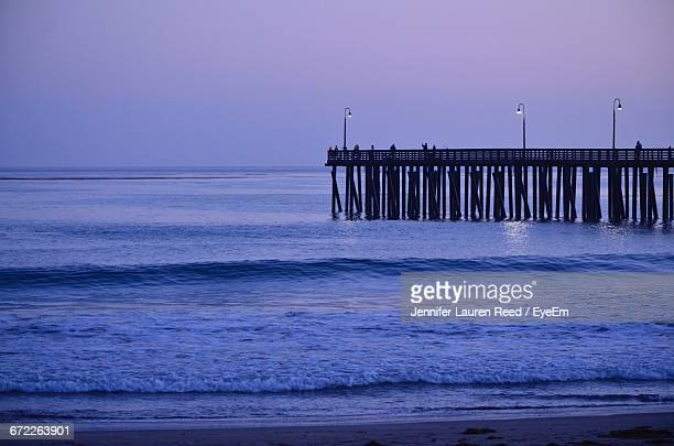 Silhouette Of Pier On Sea