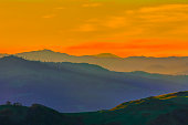 Silhouette of remote hills under sunset sky