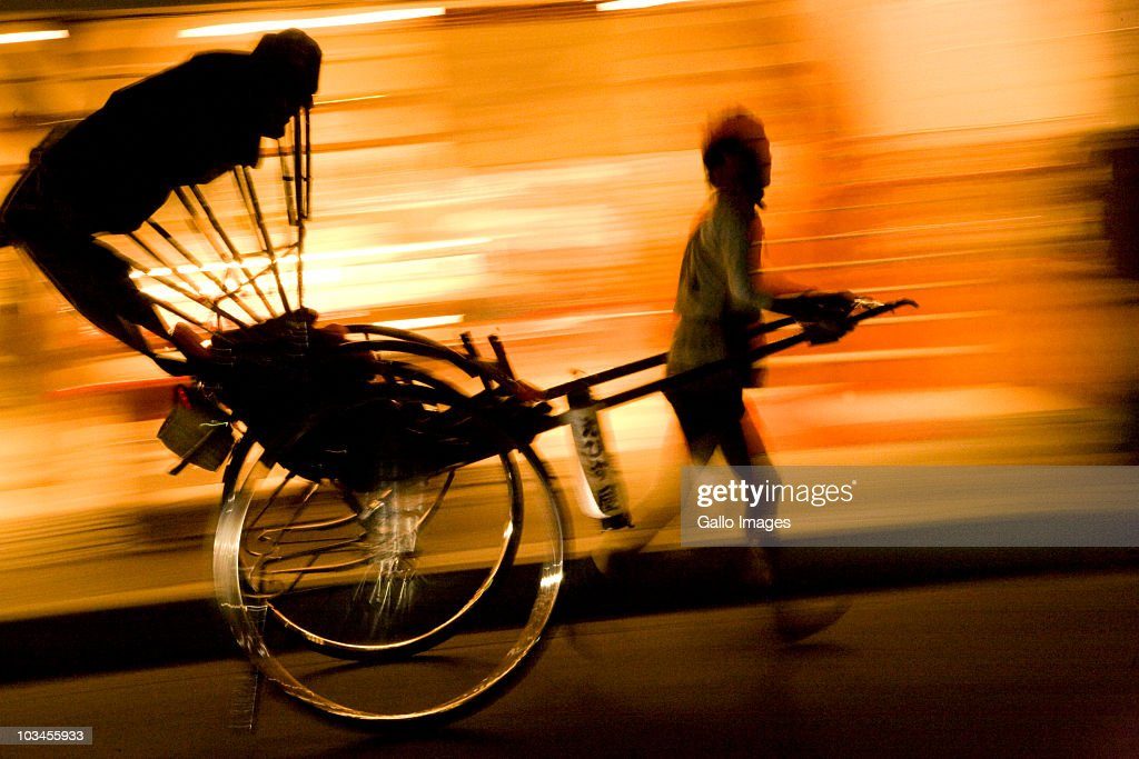 Silhouette of rickshaw in motion at night, Arashiyama, Kyoto, Honshu island, Japan : Stock Photo