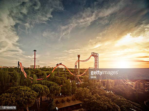 Silhouette of roller coaster at sunset