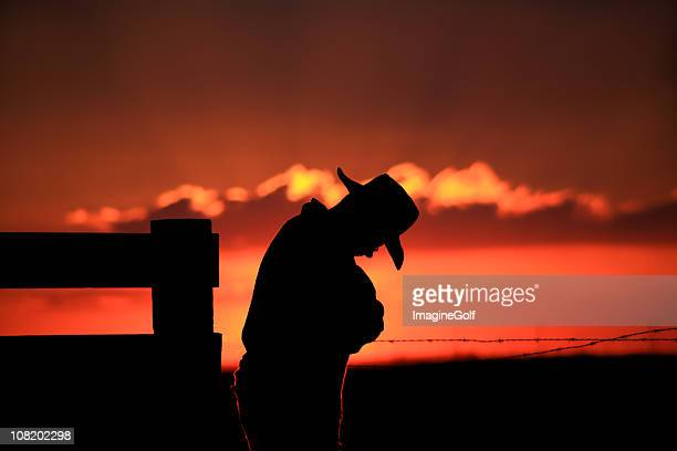 Silhouette of Sad Cowboy