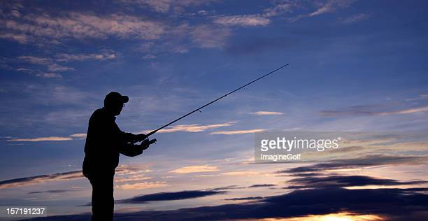 Silhouette of Senior Man Fishing