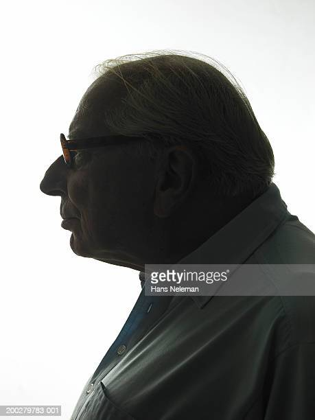 Silhouette of senior man, side view, close-up