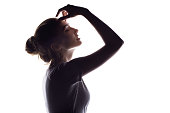 silhouette of beautiful sensual girl, woman face profile on white isolated background, concept of beauty and fashion