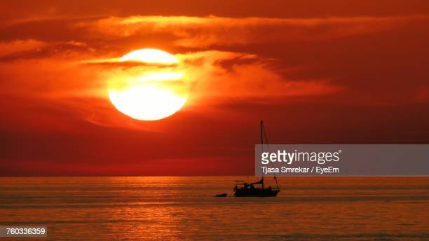 Silhouette Of Ship In Sea During Sunset