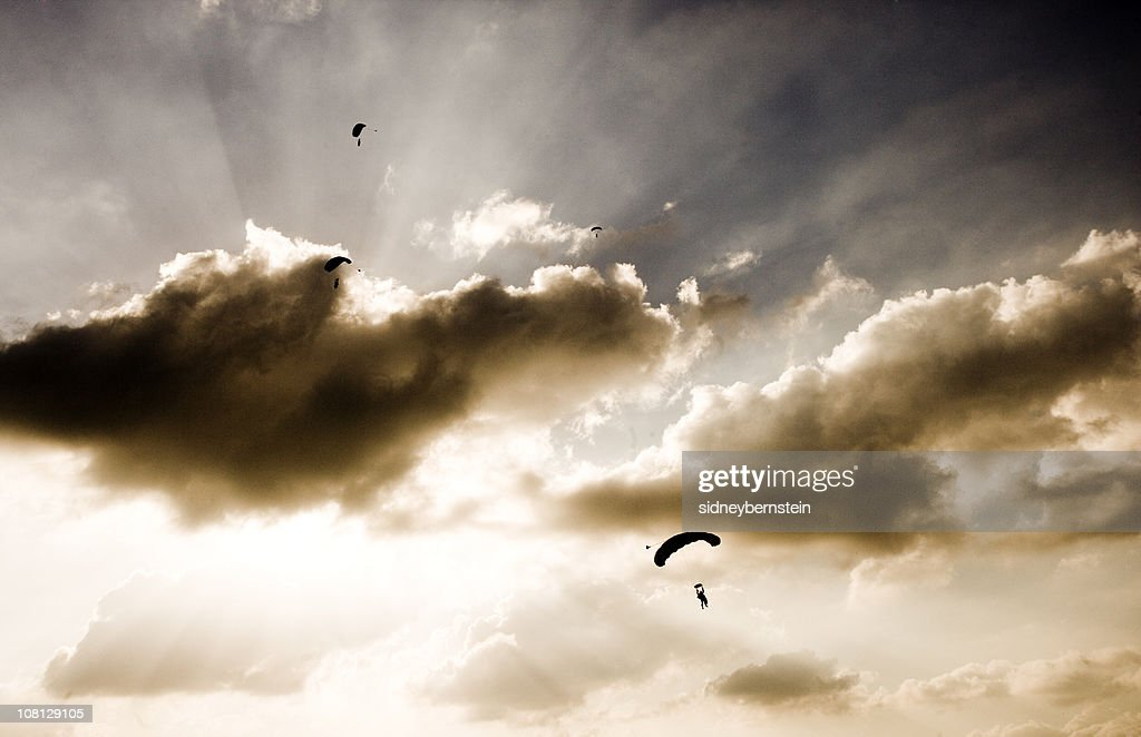 Silhouette of Skydivers on Cloudy Day in Sky : Stock Photo