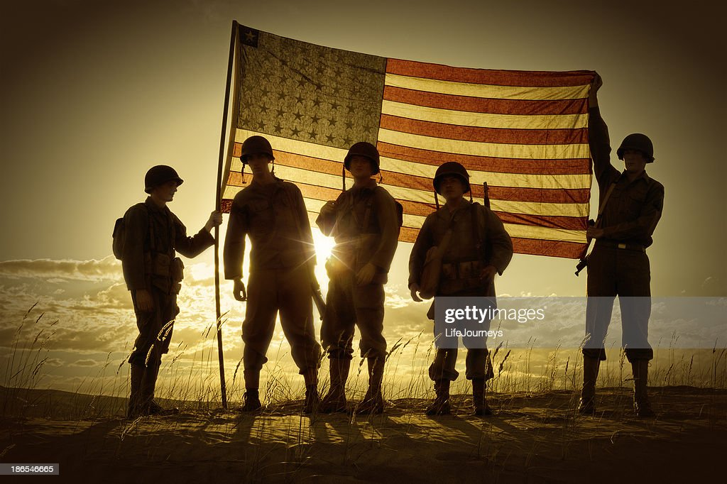 Silhouette of soldiers with American flag : Stock Photo