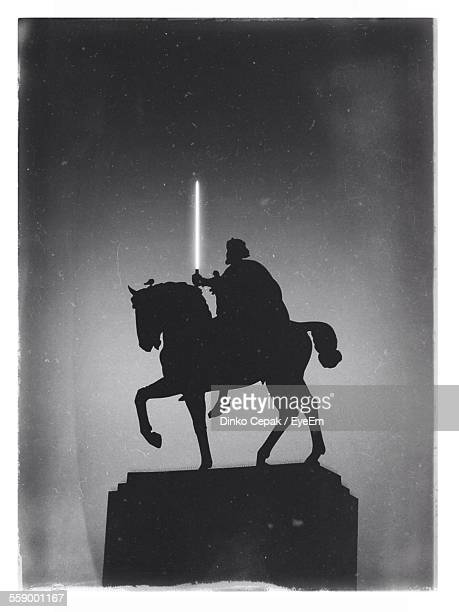 Silhouette Of Statue Of Man On Horse