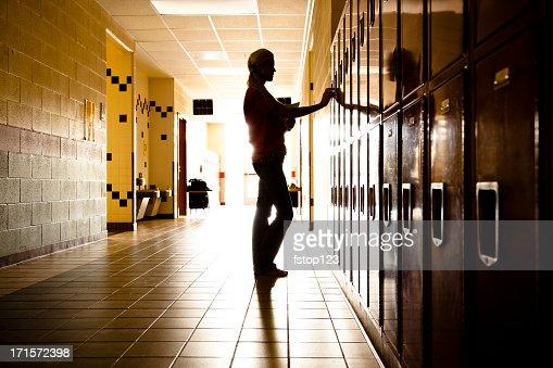 Silhouette of Student in hallway. Lockers. High school. Girl. Education.
