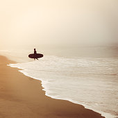 Foggy Beach With Surfer Silhouette in Fog