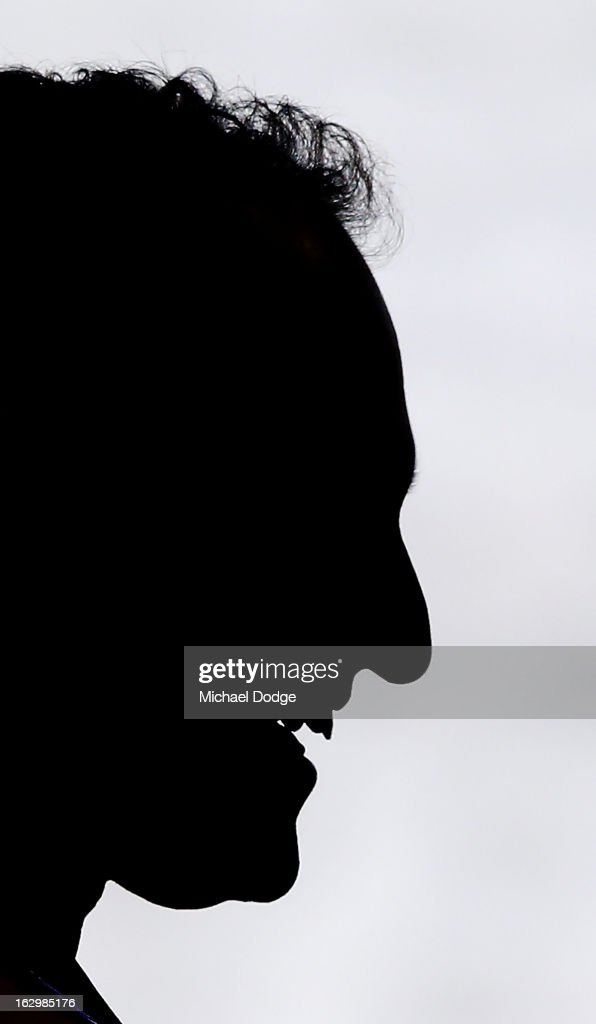 A silhouette of Sydney Swans coach John Longmire during the round two AFL NAB Cup match between the St Kilda Saints and the Sydney Swans at Etihad Stadium on March 3, 2013 in Melbourne, Australia.