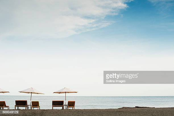 Silhouette of tables and chairs on beach