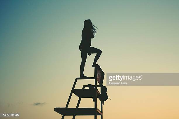 Silhouette of Teenage Girl on Lifeguard Chair