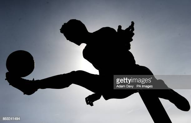 A silhouette of the Dennis Bergkamp statue outside the Emirates