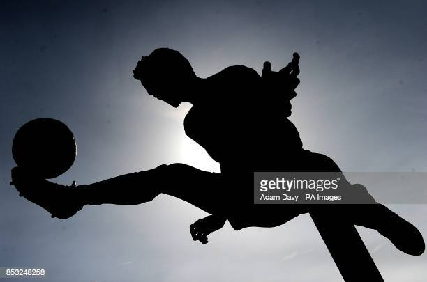 A silhouette of the Dennis Bergkamp statue outside the Emirates Stadium