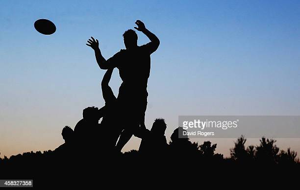 A silhouette of the England team practicing lineouts during the England training session held at Pennyhill Park on October 28 2014 in Bagshot England