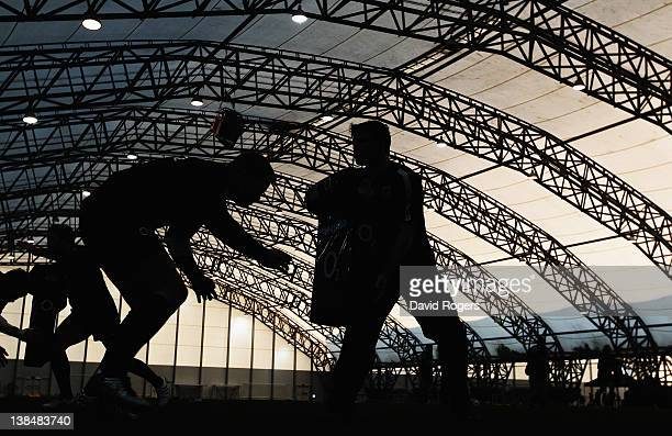 Silhouette of the England team taking part in tackle practice during the England training session held at the Soccer Dome on February 7 2012 in...